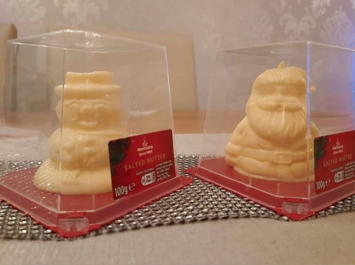 Festive-Themed Butter in the Shape of a Snowman and Santa.- from Wednesday