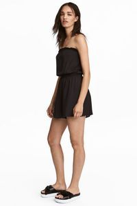 Black playsuit in sizes 6, 8 and 10